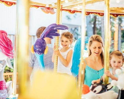 family-on-the-looney-tunes-carousel-ride-at-movie-world